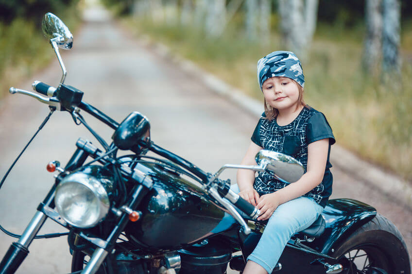small girl on motorcycle as image for the blog post on motorcycle insurance