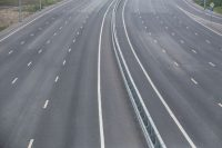 Image of empty highway for blog post on do telematics devices save money?